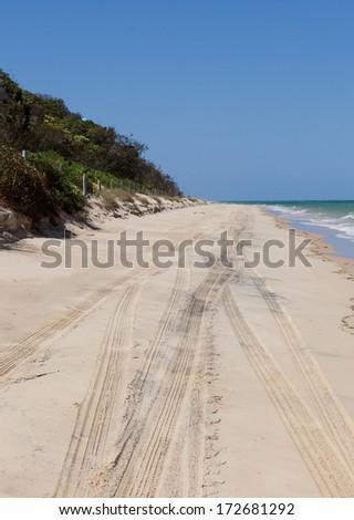 4 wheel driving on queensland moreton island beach - stock photo
