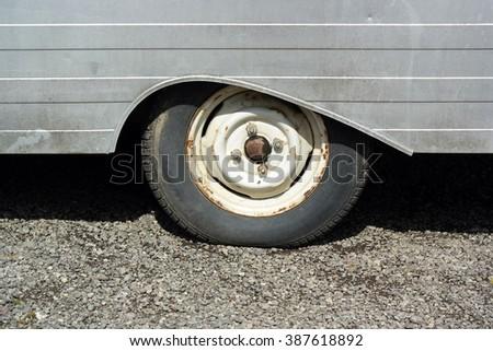 Wheel in teardrop shaped wheel arch. - stock photo