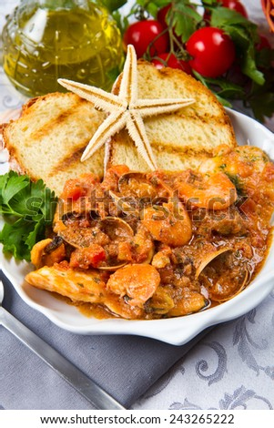 White bowl of fresh seafood soup   - stock photo
