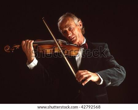 white european senior male playing the violin - stock photo