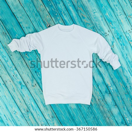 White hoody on blue background. With no images copyspace for your information logo emblem. Front Top view. Other clothing for children and adults in my portfolio  - stock photo