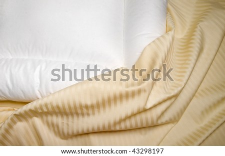 white orthopedic pillow with  beige  sheets - stock photo