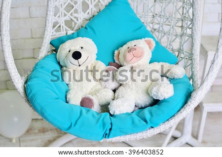 White toys in the chair - stock photo
