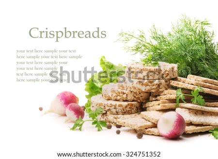 Whole grain cereal crispbread made from buckwheat, rye, wheat and oats, radish and dill isolated on a white background closeup - stock photo