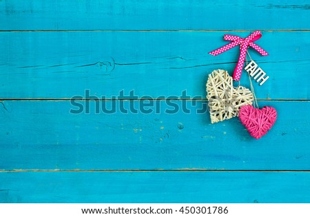 Wicker and rope hearts with FAITH hanging on antique rustic teal blue wood background; Valentine's Day and love concept - stock photo