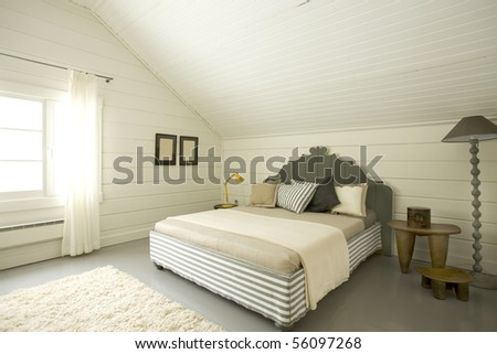 wide bedroom in the attic - stock photo