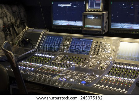 Wide shot of vision mixing panel in a television gallery. - stock photo