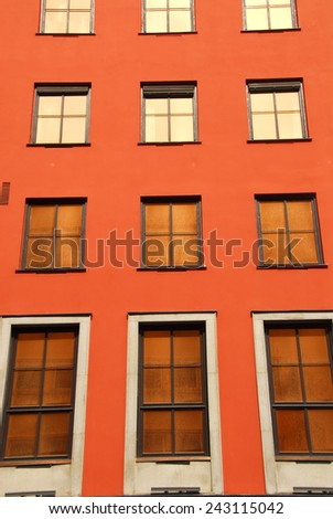2-window frame exterior in red wall - stock photo