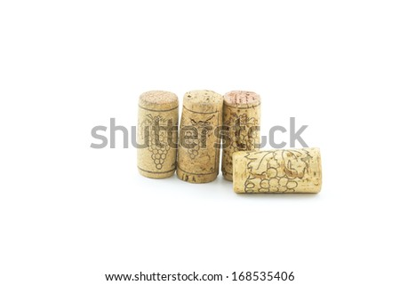 wine corks and wineglass on white background. - stock photo