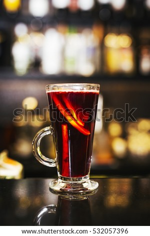 Winter blackcurrant drink with cinnamon and lemon