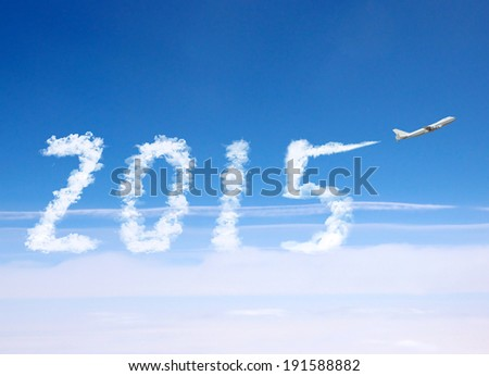 2015 with airplane. - stock photo