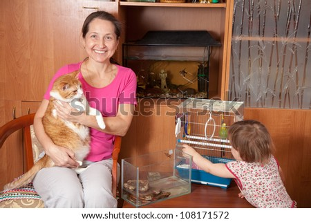 woman and child with  pets in home
