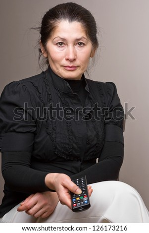 Woman  and   control panel TV - stock photo