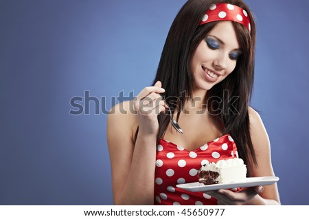 Woman eating chocolate cake - stock photo