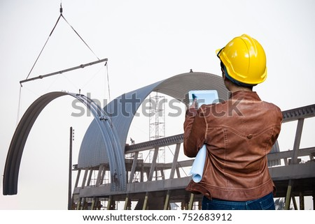Delightful Woman Engineer Contractor Control Crane Lifting Shell Unless Frame Metal  Sheet Roofing Construction Site Work