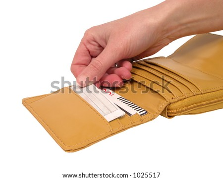 Woman hand pulling credit card out of a wallet-isolated over white background with clipping path - stock photo