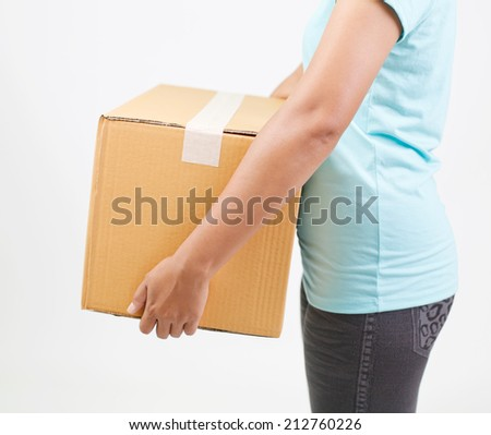 Woman Holding Box - stock photo