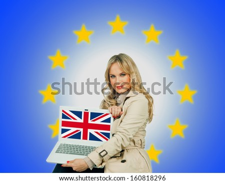 woman holding laptop with united kingdom flag on the screen and european union stars in the background - stock photo