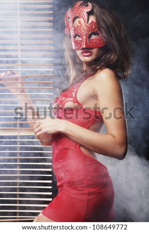 woman in red with mask - stock photo