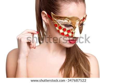 Woman in venetian mask. Carnival mask Close-up female portrait. New year party - stock photo