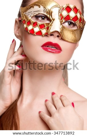 Woman in venetian mask..Carnival mask Close-up female portrait. New year party - stock photo