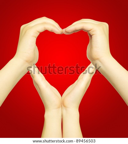 woman's hands made in the form of heart - stock photo