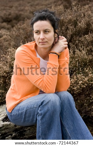 woman sitting and watching to camera - stock photo