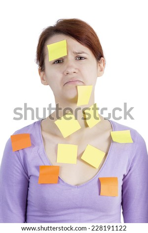 Woman with stickers on her,with a sad emotion, a lot of things to do - stock photo