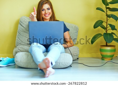 woman working with laptop at home. thumb show. Smiling woman.  - stock photo