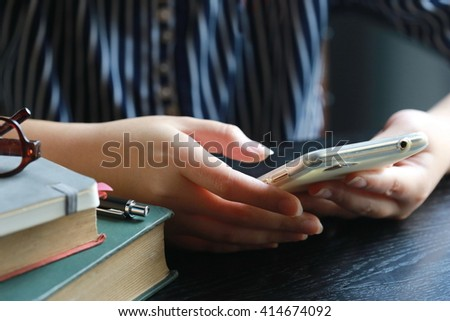 women hand use phone in coffee shop - stock photo
