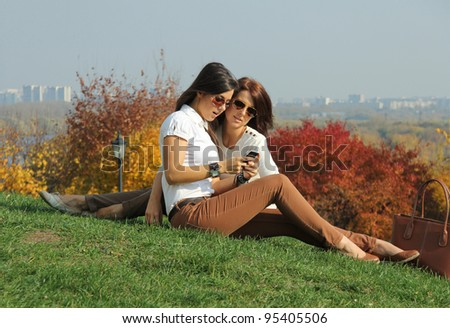 women with autumn maple leaves in park at fall outdoors - stock photo