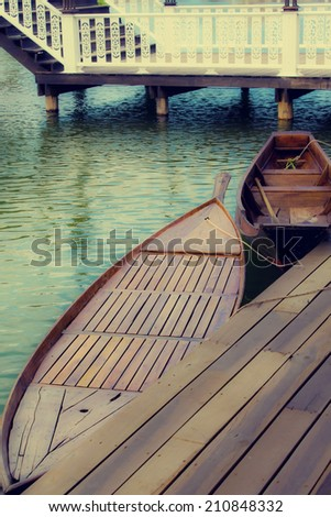 wood boat in floating market Thailand  - stock photo