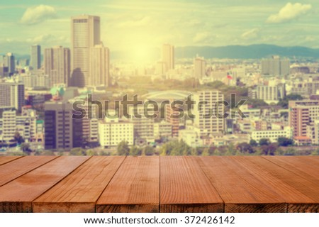 Wood table top with  blurred background of  The city of Osaka, in the Kansai region and Osaka prefecture - can be used for montage or display your products