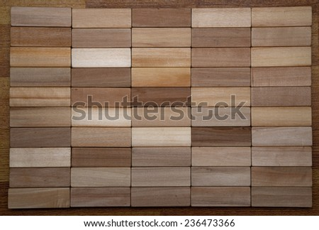 50 wooden dice of different tones of wood - stock photo