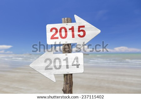 2015 wooden sign at the beach on background  - stock photo