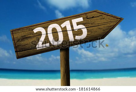 2015 wooden sign with a beach on background - stock photo