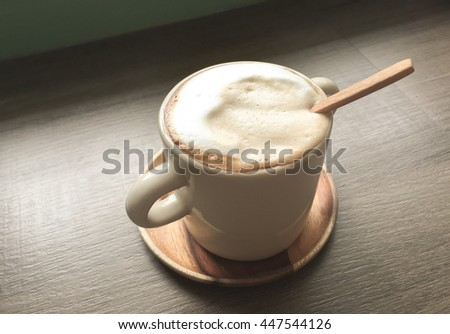 Wooden spoon in coffee cup, Relax time with Coffee in coffee cafe - stock photo