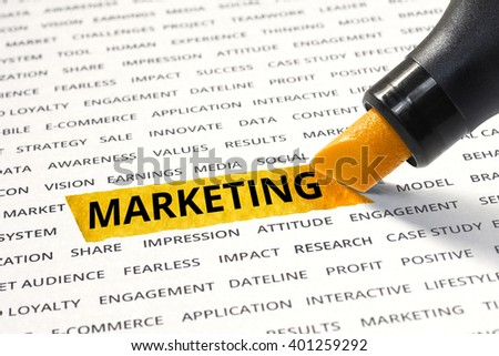 Word marketing highlighted with marker on paper of other related words. For direction of business strategy success concept - stock photo