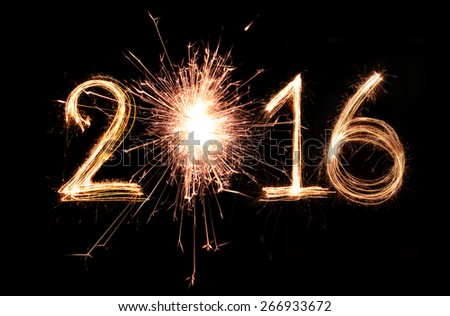2016 word written with Sparkle firework on black background - stock photo