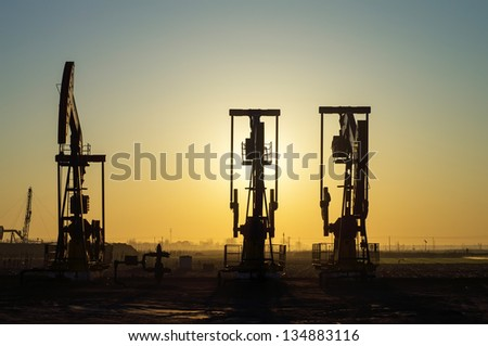 Work of oil pump jack on a oil field. Oil and gas industry. - stock photo
