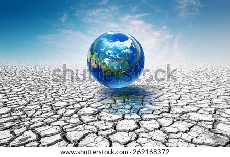 world ball on the soil cracked.Elements of this image furnished by NASA .a glass building in which plants are grown that need protection from cold weather.United Nations Climate Change Conference - stock photo