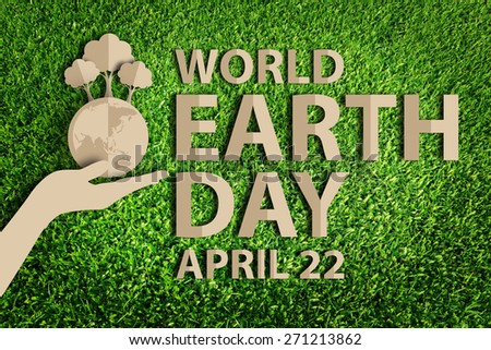 World earth day concept. Paper cut of eco on green grass. - stock photo