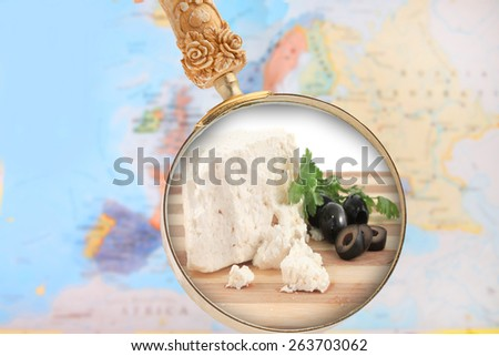 World foods showing Europe with magnifying glass looking in on Feta Cheese  from Greece - stock photo