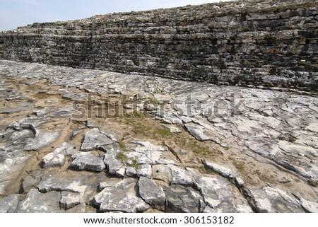 worn rocky forms  along a rough coastline - stock photo
