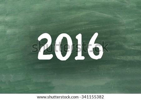 2016 written on a chalkboard - stock photo