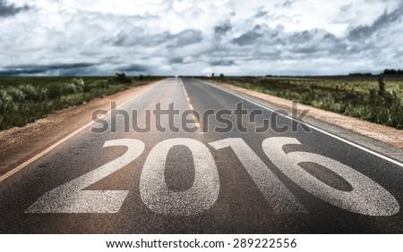 2016 written on rural road - stock photo
