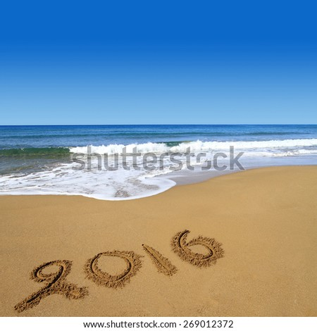 2016 written on sandy beach - stock photo