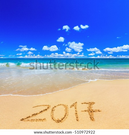 2017 written on sandy beach
