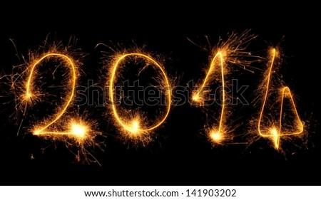 2014 written with fireworks, symbolizing new years eve - stock photo
