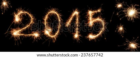 2015 written with sparklers on black